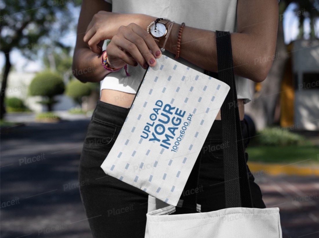 mockup of a young woman carrying a cosmetic pouch