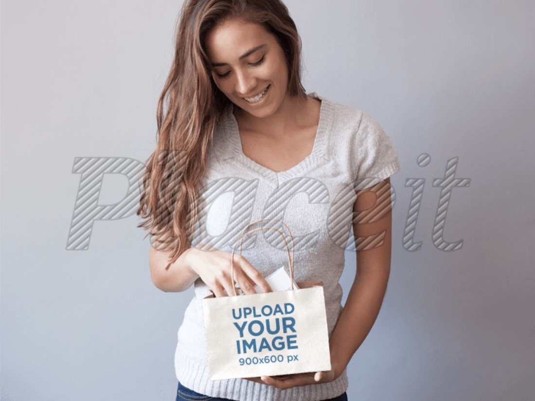 mockup of a young woman holding a shopping bag