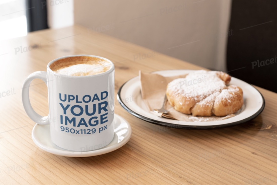 mockup of an 11 oz coffee mug and a croissant