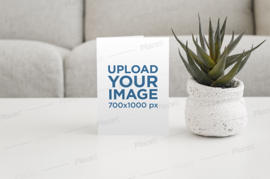 mockup of an invitation card and a cactus