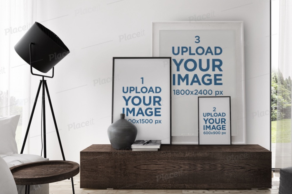 mockup of three art prints of different sizes in a living room