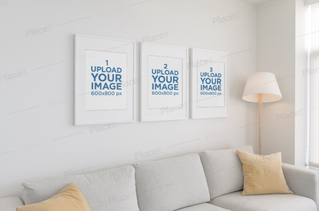 mockup of three poster frames hanging on a white wall