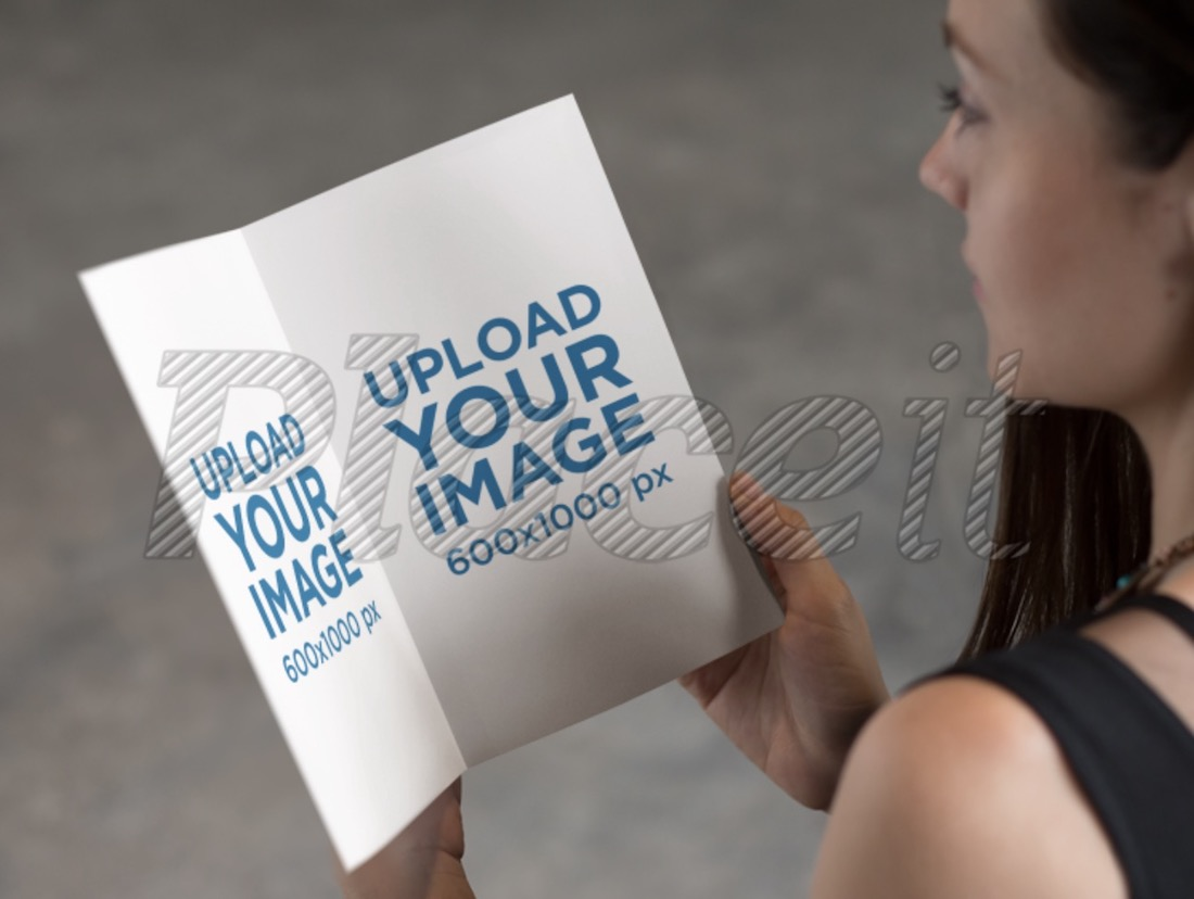 mockup template of a woman reading a pamphlet