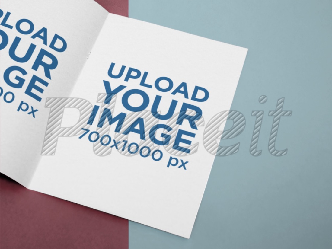 open booklet mockup lying on a two color surface