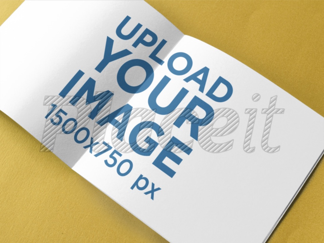 open booklet on a yellow surface mockup
