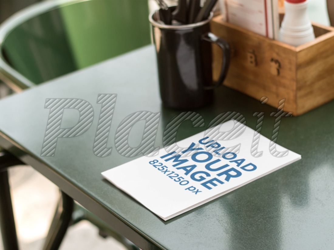 pamphlet lying on top of table mockup