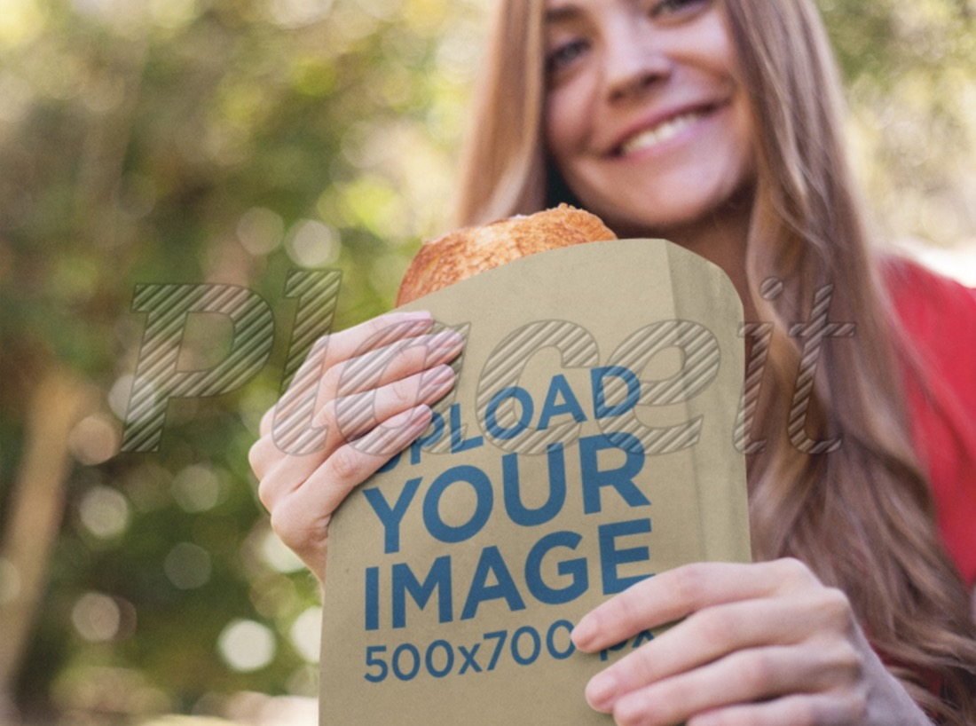 paper bag mockup featuring a young woman eating a sandwich