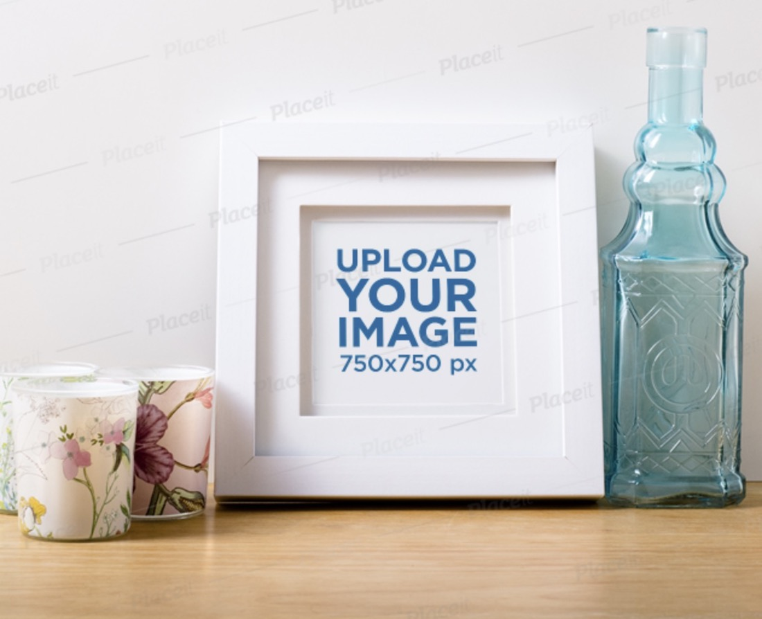 photo frame mockup featuring candles and a glass bottle