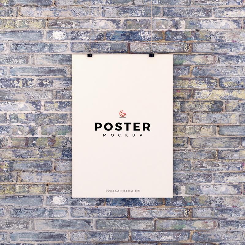poster hanging on brick wall mockup