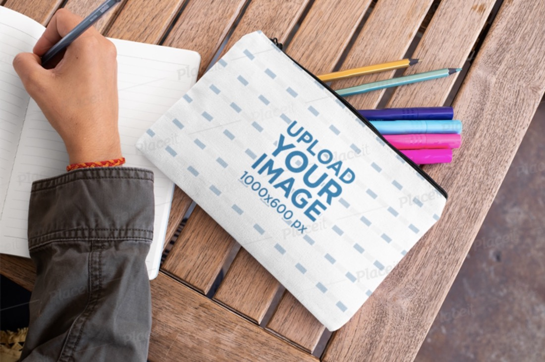 pouch mockup of a woman writing in a notebook