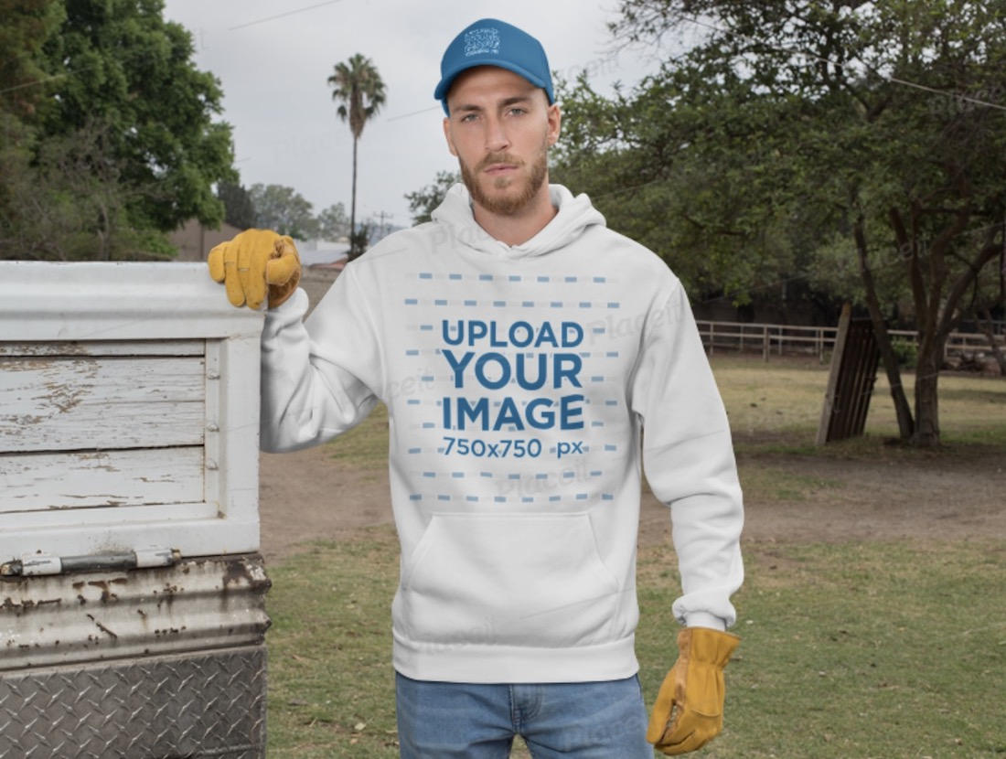 ranch worker wearing a hoodie and a trucker cap mockup