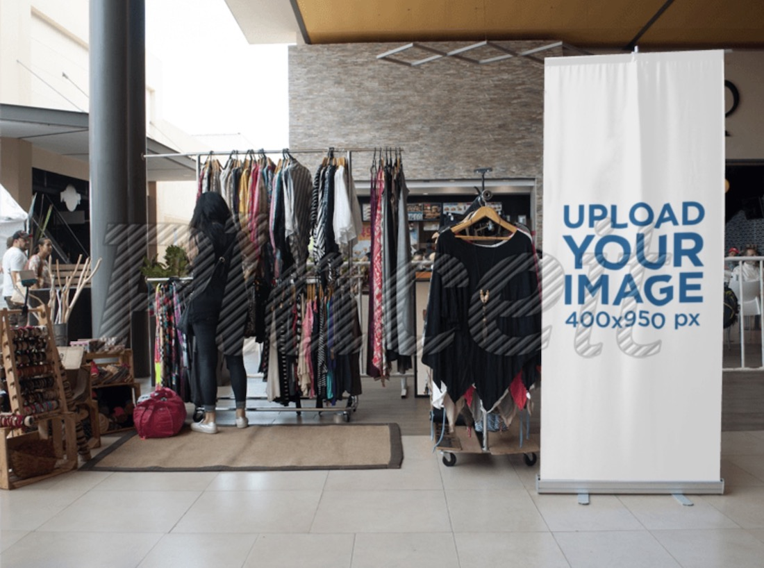 roll up banner standing next to a boho clothing bazar