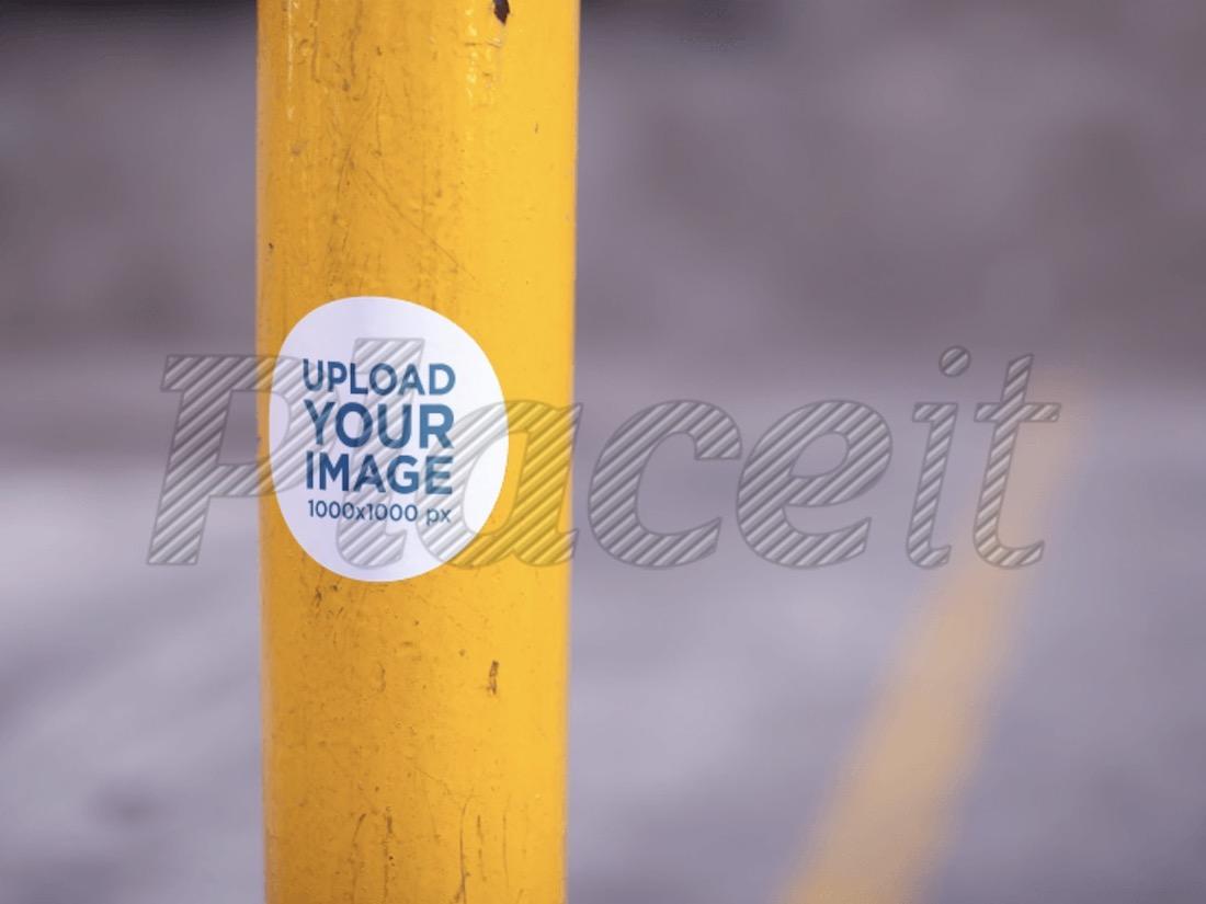 round sticker on a yellow pole