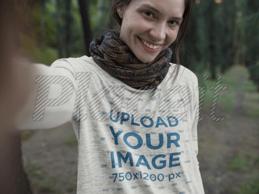 selfie of a happy girl wearing a bella canvas flowie long sleeve tee mockup