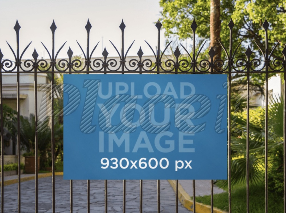 signage mockup on a fence at a fancy house