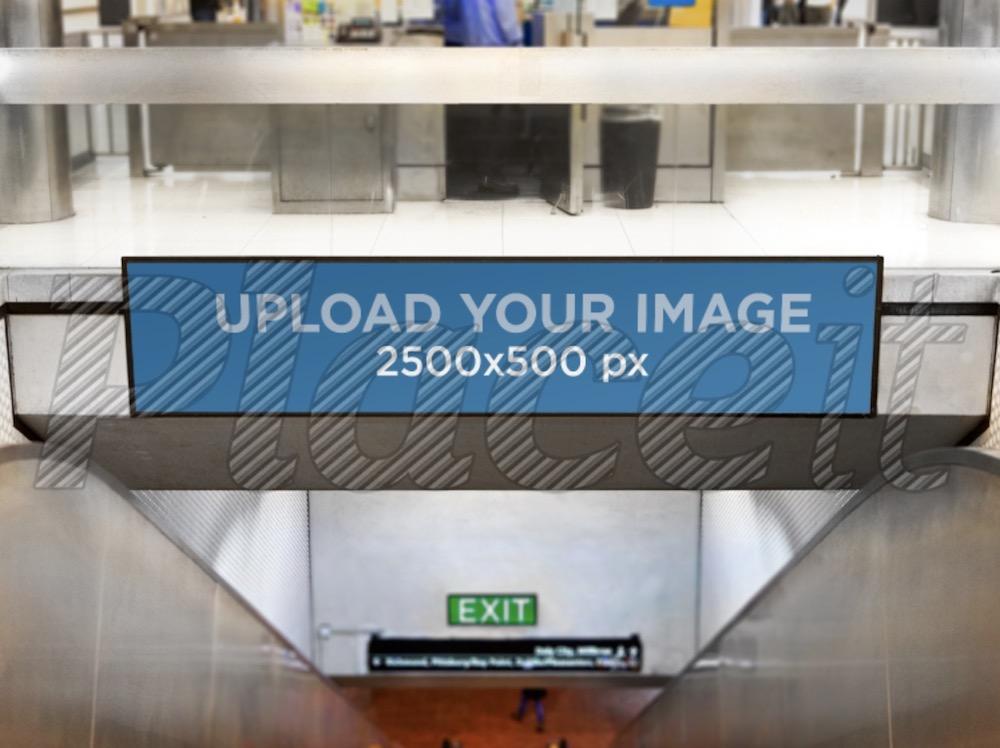 signage mockup template over a mall escalator