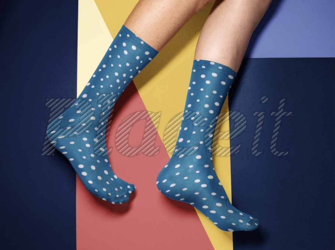 socks mockup in front of a multicolor background