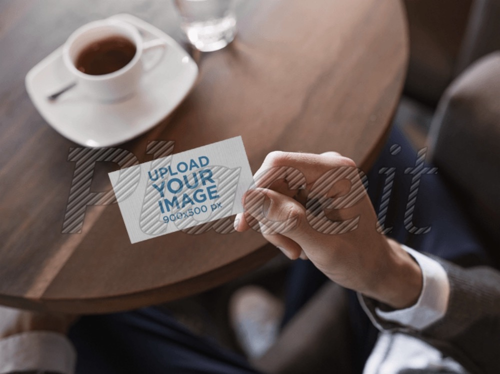 sophisticated mockup of a business card in a cafe