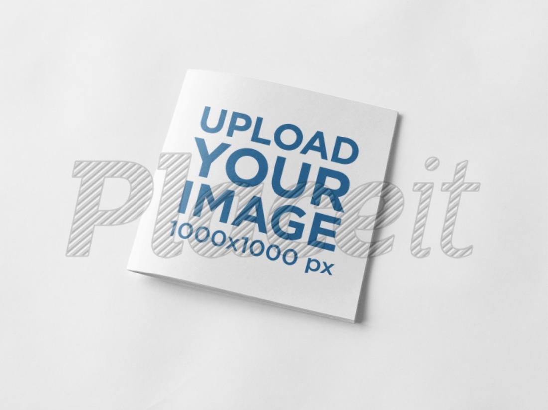 square booklet lying over a white surface mockup
