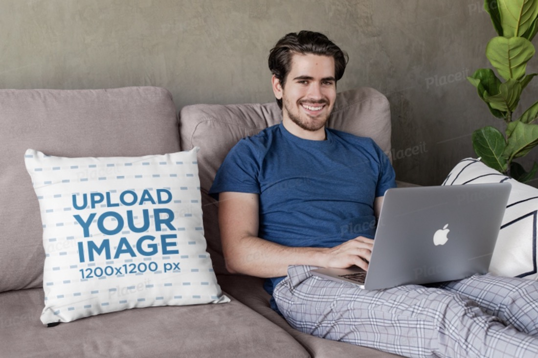 square pillow mockup featuring a young man sitting on a couch