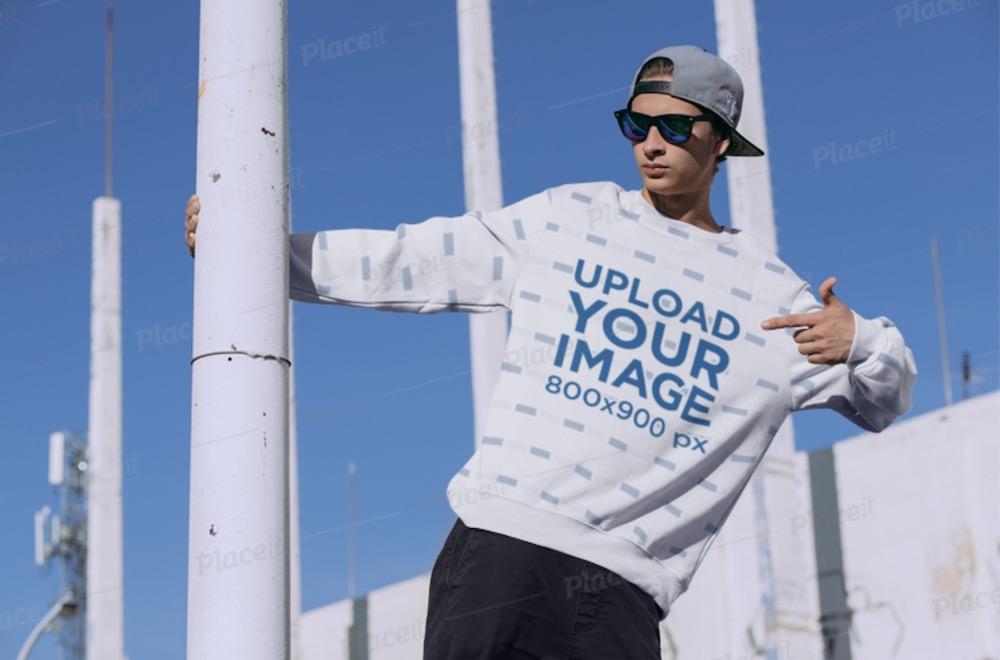 sublimated crewneck sweatshirt mockup featuring a man outdoors