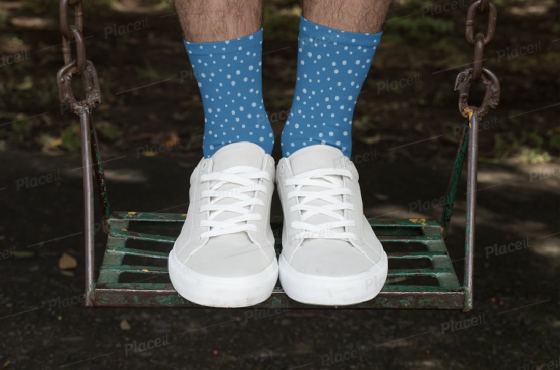 sublimated socks mockup featuring a man standing on a swing