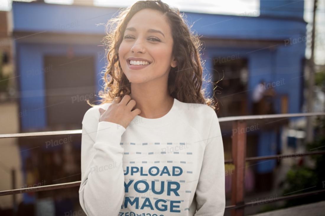 sweatshirt mockup of a happy woman on a balcony