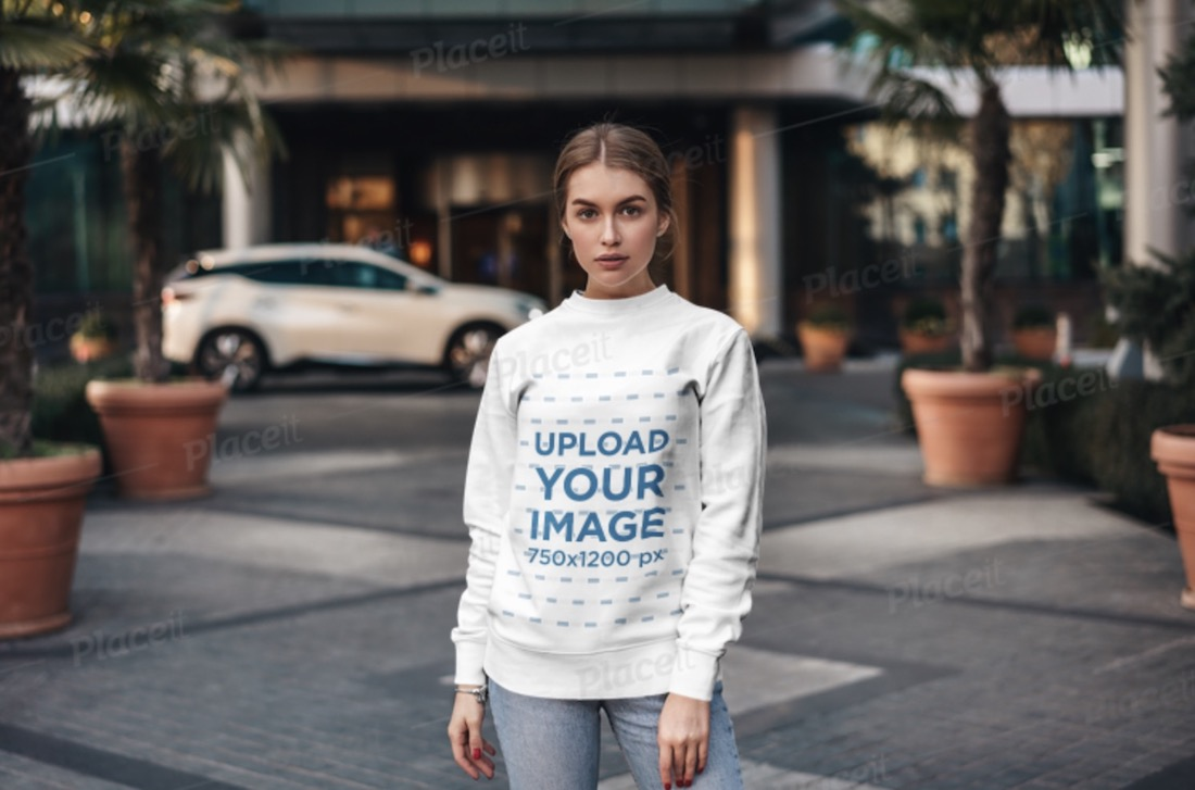 sweatshirt mockup of a woman posing in the middle of a walking lane