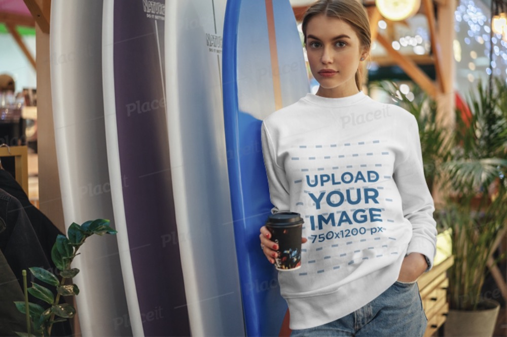 sweatshirt mockup of a young woman leaning on some surfboards