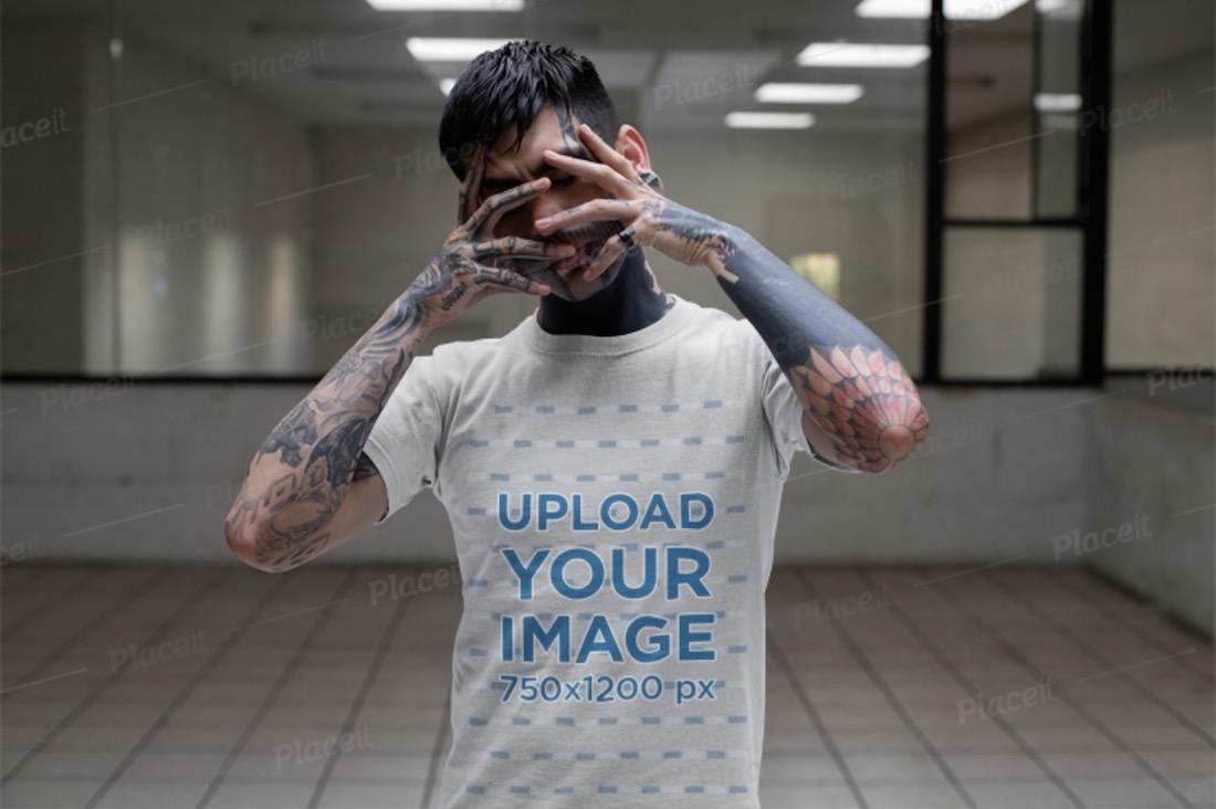 t-shirt mockup of a tattooed man