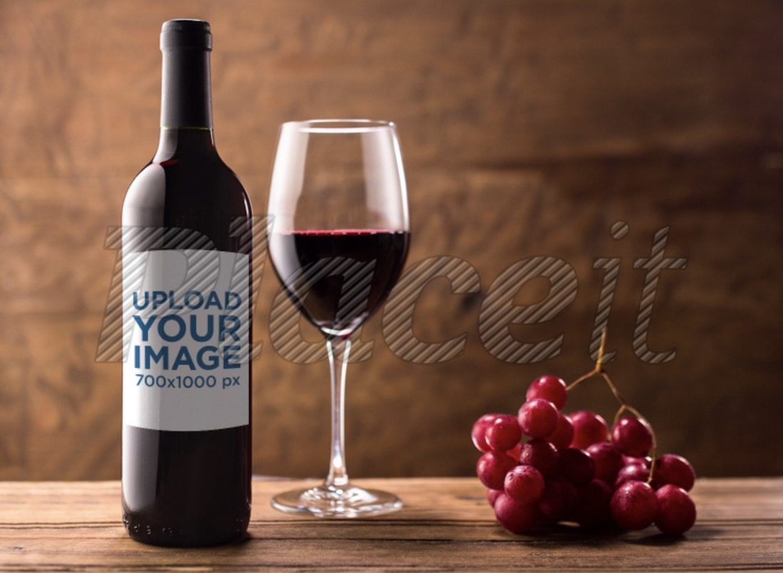template of a red wine on a wooden table with grapes