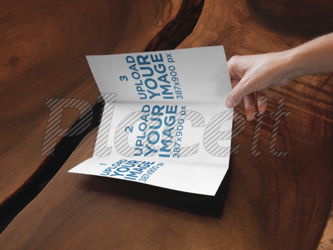 trifold brochure mockup in a person hand
