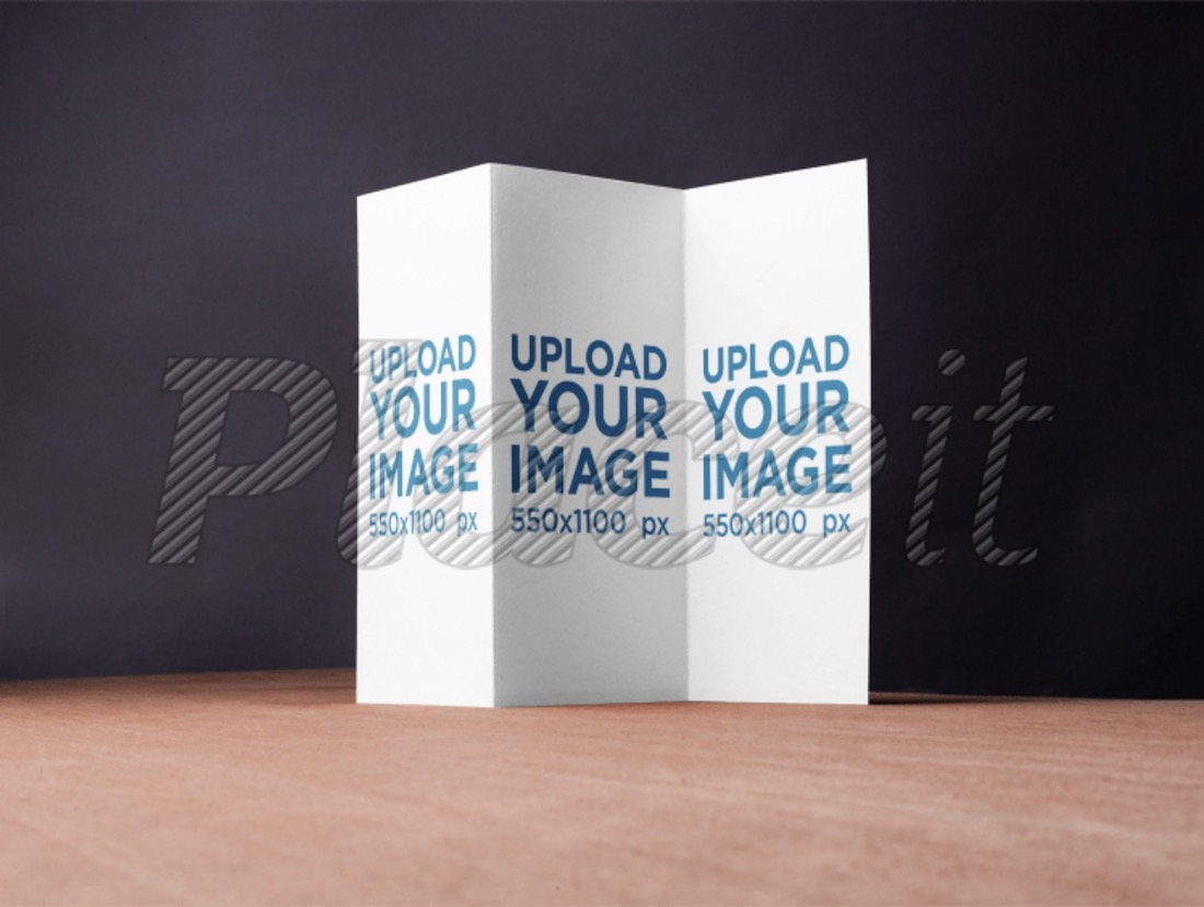 trifold brochure mockup on a wooden surface