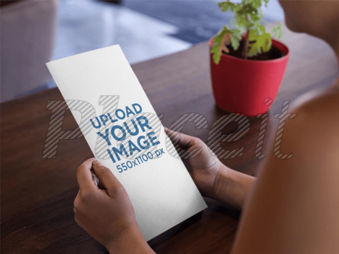 woman looking at a menu booklet