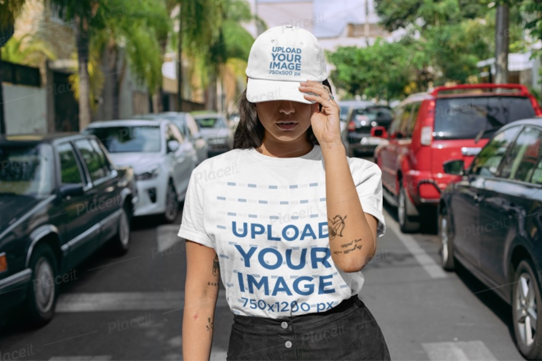 woman standing in the street wearing a t-shirt mockup