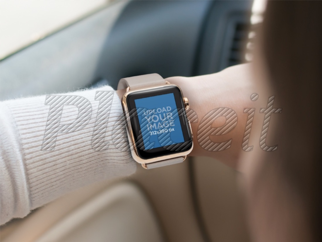 woman wearing a gold apple watch