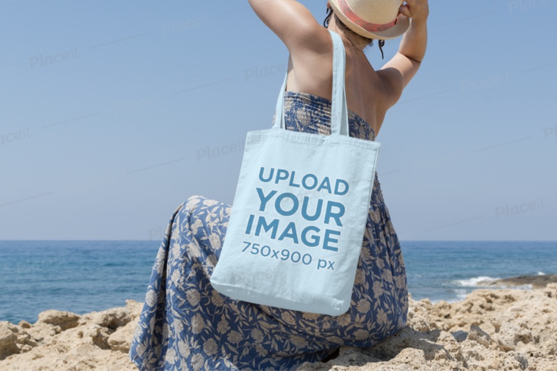 woman wearing a tote bag on the beach mockup