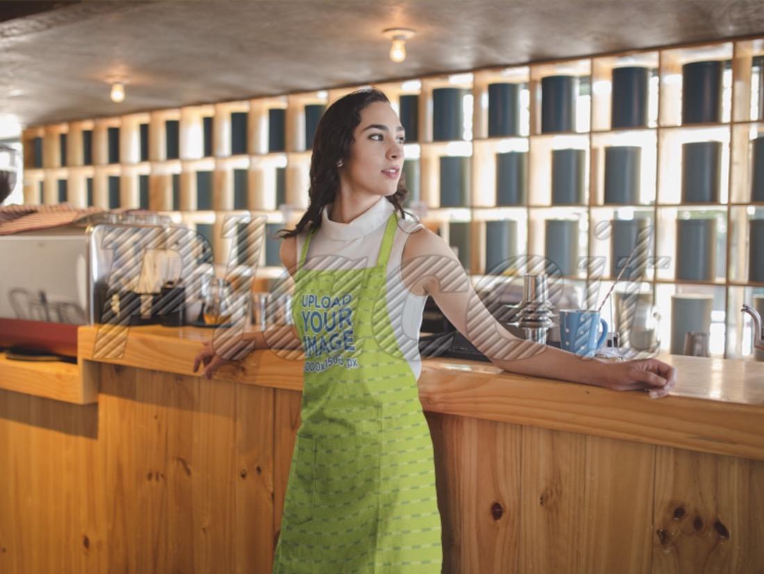 woman wearing an apron mockup at a tea bar
