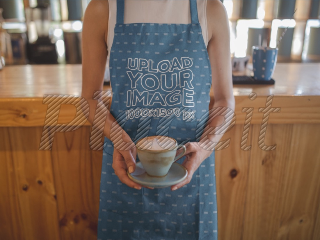 woman wearing an apron serving coffee