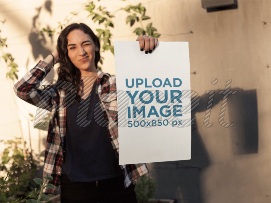 woman winking while holding a poster