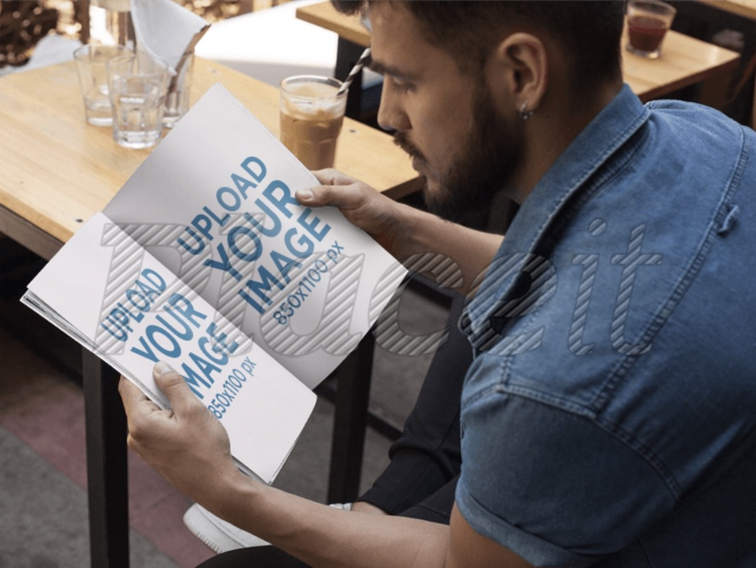 young man with beard reading a magazine mockup