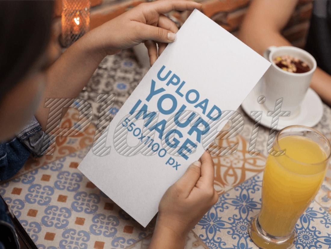 young woman reading a vertical restaurant menu mockup