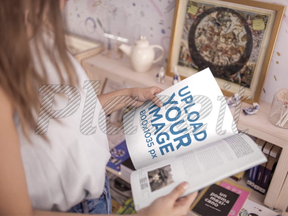 young woman taking a peek at a magazine in a store